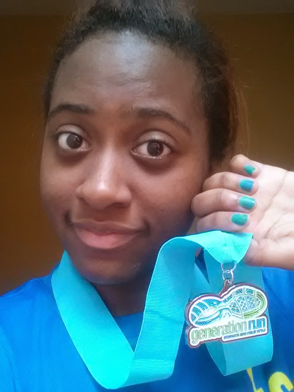 Girl holding a medal near her face