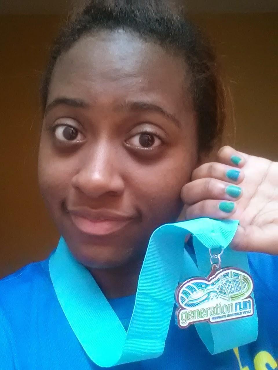 Girl holding a medal near her face